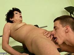 Dude has a nice granny on his dick sucking him