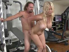 Blonde bosomy milf gets fucked good in a gym