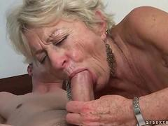 Mature bitch and a handsome dude enjoying hard sex together