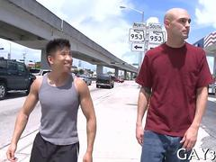 Short Asian dude fucks a tall bald whitey out in public