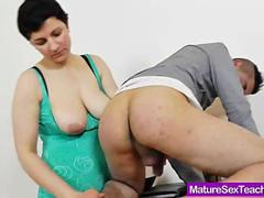 Mamma teacher giving a handjob
