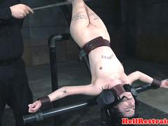 Inverted submissive chastised with caning