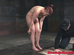 Submissive tormented with whip and kicks
