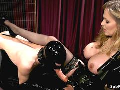 Slave in gimp mask sucks strap on cock