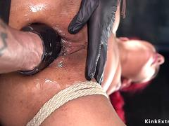 Ebony slave fisted and made squirting