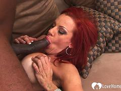 Redhead with big tits takes a black cock
