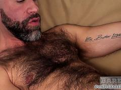 Hairy bear wanking his throbbing dong