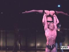 Swinger couples enjoy acrobatic sexual show. Naked women and people flying make part of the show.
