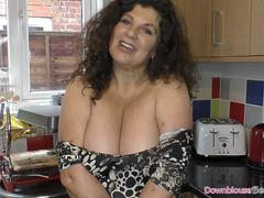 Brunette mature woman with big natural tits showing downblouse