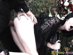 Inked goth at funeral