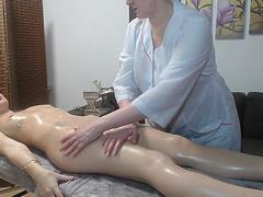 Lesbian mature doing sexy massage with oil to redhead girl