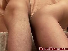 Jock is giving blowjob while bare banged in threesome