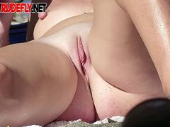 Big boob and slim girl nudists lay out in the sun