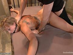 Wide spread blonde anal fucked in bdsm