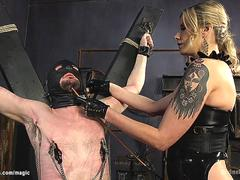 Mistress canes and pegs bound man