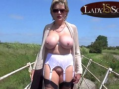 Mature babe Lady Sonia plays with her pussy outdoors
